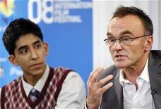 "<p>Director Danny Boyle (R) speaks beside actor Dev Patel during the "" Slumdog Millionaire"" news conference at the 33rd Toronto International Film Festival September 8, 2008. REUTERS/ Mike Cassese</p>"