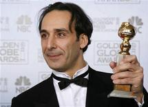 "<p>Alexandre Desplat poses with his award for best original score - motion picture for ""The Painted Veil"" at the 64th annual Golden Globe Awards in Beverly Hills, California January 15, 2007. REUTERS/Mike Blake</p>"