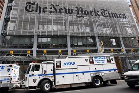 New York City police vehicles are seen outside the New York Times headquarters building in New York in this file photo from October 22, 2008. REUTERS/Mike Segar