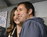 "<p>Adam Sandler poses with wife Jackie at the premiere of his new film ""Bedtime Stories"" in Hollywood, California December 18, 2008. REUTERS/Fred Prouser</p>"