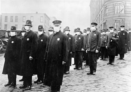 Policemen in Seattle wearing masks made by the Red Cross, during the influenza epidemic in a National Archives photo dated December 1918. REUTERS/National Archives/Handout