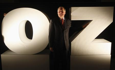 Oz Minerals Chief Executive Andrew Michelmore poses for photographers with the company's logo in Melbourne in this June 16, 2008 file photo. REUTERS/Mick Tsikas/Files