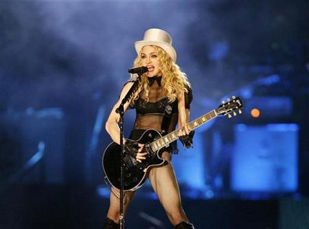Madonna performs during the Los Angeles date of her ''Sticky and Sweet'' tour at Dodgers stadium in Los Angeles, November 6, 2008. REUTERS/Mario Anzuoni