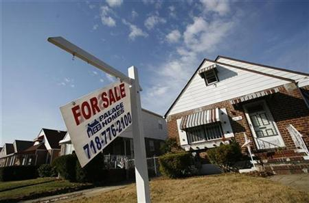 A broken ''For Sale'' sign is seen outside a home in the Queens borough of New York, November 21, 2008. REUTERS/Shannon Stapleton