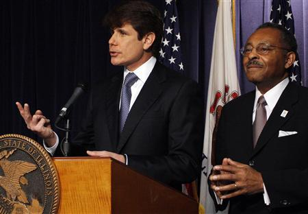 Illinois Governor Rod Blagojevich (L) announces former Illinois Attorney General Roland Burris as his choice to fill the vacant U.S. Senate seat of President-elect Barack Obama during a news conference in Chicago, Illinois December 30, 2008. REUTERS/Frank Polich
