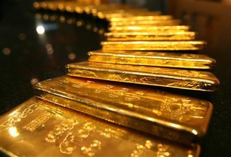 Several one-kilo gold bars are displayed inside a secured vault in Dubai April 20, 2006. REUTERS/Tamara Abdul Hadi