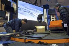 <p>Panasonic Electronics technicians set up a display of flat panel televisions for the 2009 International Consumer Electronics Show at the Las Vegas Convention Center in Las Vegas, Nevada January 5, 2009. In the background is the 150-inch plasma television which was introduced at last year's show. The consumer technology trade show begins January 8 and is expected to attract 2,700 exhibitors and 130,000 attendees. REUTERS/Las Vegas Sun/Steve Marcus</p>
