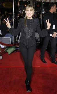 Catherine Hardwicke gestures at the premiere of the movie ''Twilight'' at the Mann Village and Bruin theatres in Westwood, California November 17, 2008. REUTERS/Mario Anzuoni