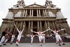 <p>Members of the Ewell St. Mary's Morris Men's folk dancers perform in front of London's St. Paul's cathedral as part of Saint George's Day celebrations April 23, 1997. REUTERS/Dennis Owen</p>