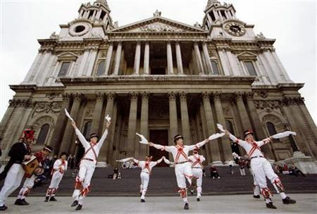 Members of the Ewell St. Mary's Morris Men's folk dancers perform in front of London's St. Paul's cathedral as part of Saint George's Day celebrations April 23, 1997. REUTERS/Dennis Owen