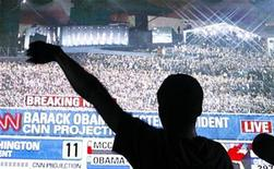 <p>A supporter of Democratic presidential nominee Barack Obama (D-IL) watches as he is declared the winner of the 2008 presidential election in Times Square in New York November 5, 2008. REUTERS/Lucas Jackson</p>