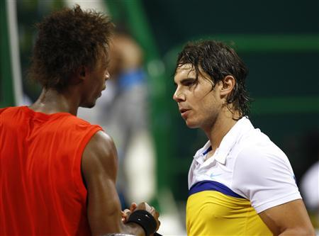 Gael Monfils (L) of France shakes hands with Spain's Rafael Nadal after Monfils' win at the ATP Qatar Open tennis tournament in Doha January 8, 2009. REUTERS/Steve Crisp