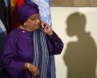 <p>Liberia's President Ellen Johnson-Sirleaf speaks on a phone as she arrives for a dinner for the 63rd United Nations General Assembly at the U.N. Headquarters in New York, September 23, 2008. REUTERS/Jim Young</p>