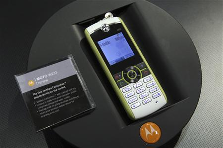 A MOTO W233 ''renew'' phone by Motorola is displayed during the first day of the 2009 International Consumer Electronics Show (CES) in Las Vegas, Nevada, January 8, 2009. The phone's plastic is made from recycled water cooler bottles and carbon offsets have been purchased to counter the energy needed to produce, use and dispose of the phone, a Motorola representative said. The consumer technology trade show runs through January 11 and is expected to attract 2,700 exhibitors and 130,000 attendees. REUTERS/Steve Marcus