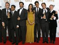 "<p>The cast of ""Slumdog Millionaire'' pose backstage after the show won four awards at the 66th annual Golden Globe awards in Beverly Hills, California January 11, 2009. Pictured are (L-R) Danny Boyle, who won for Best Director- Motion Picture, A.R. Rahman who won for Best Original Score, Anil Kapoor, Freida Pinto, Dev Patel, producer Christian Colson for Best Motion Picture- Drama, and writer Simon Beaufoy for Best Screenplay. REUTERS/Lucy Nicholson</p>"