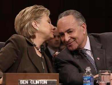 Hillary Clinton talks to Senator Charles Schumer during her confirmation hearing before the Senate Foreign Relations Committee on Capitol Hill, January 13, 2009. REUTERS/Yuri Gripas