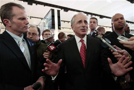 Senator Bob Corker (R-TN) answers a question from the media as Michigan Attorney General Mike Cox (L) listens at the North American International Auto Show in Detroit, Michigan January 13, 2009. Cox wrote a column in Monday's Washington Post inviting every member of the U.S. Senate to visit the show. REUTERS/Rebecca Cook