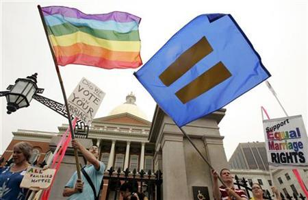 Demonstrators wave flags in support of gay marriage in front of the Massachusetts State House in Boston, Massachusetts, July 12, 2006. REUTERS/Jessica Rinaldi