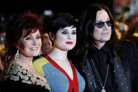 Sharon (L), Kelly (C) and Ozzy Osbourne arrive at the Brit Awards at Earls Court in London February 20, 2008. REUTERS/Luke MacGregor