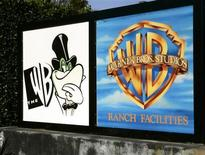 <p>A sign for the WB television network (L) is shown at the network's offices on the Warner Bros. studios Ranch facilities lot in Burbank, California January 24, 2006. REUTERS/Fred Prouser</p>