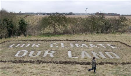 A man walks across a field owned by activists opposed to the expansion of Heathrow Airport, in the Village of Sipson, west of London January 15, 2009. REUTERS/Stephen Hird