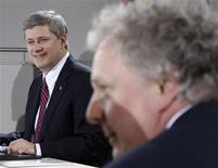 <p>Prime Minister Stephen Harper (L) and Quebec Premier Jean Charest wait for the start of the First Ministers' meeting in Ottawa January 15, 2009. REUTERS/Chris Wattie</p>