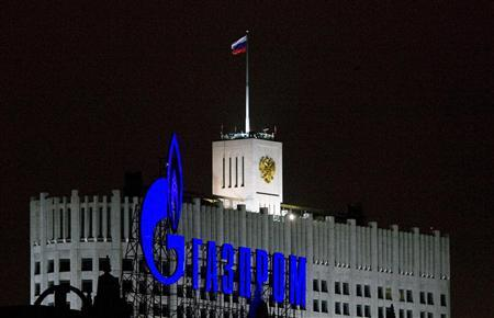 A Gazprom sign is seen in front of the White House, the seat of Russia's Prime Minister Vladimir Putin in Moscow January 14, 2009. REUTERS/Sergei Karpukhin