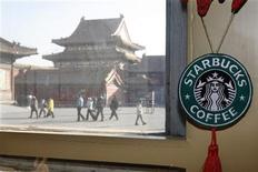 <p>A Starbucks logo hangs inside its outlet inside the Forbidden City in Beijing January 18, 2007. REUTERS/Claro Cortes IV</p>