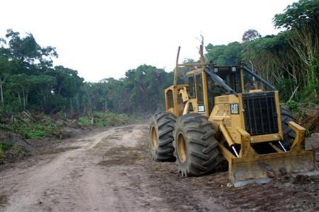 A logging company's tractor sits on the side of a road that has been cut into Congo's forest in the northern province of Equateur October 8, 2004. REUTERS/David Lewis
