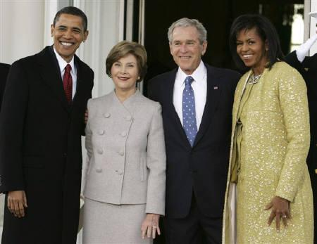 U.S. President George W. Bush greets U.S. President-elect Barack Obama (L) on the North Portico of the White House in Washington, January 20, 2009. First lady Laura Bush is second from left, and Michelle Obama is at right. REUTERS/Larry Downing