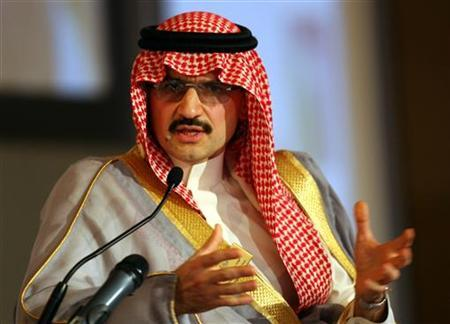 Saudi billionaire Prince Alwaleed bin Talal gestures during the Arab and World Media conference in Medinat Jumeirah in Dubai, December 5, 2005. REUTERS/Ahmed Jadallah