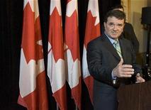<p>Canadian Finance Minister Jim Flaherty gestures as he speaks with the media in Montreal, January 6, 2009. REUTERS/Christinne Muschi</p>