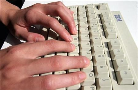 A generic picture of a woman typing on a computer keyboard. REUTERS/Catherine Benson