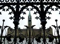 <p>The Parliament Building is framed through a gate on Parliament Hill in Ottawa, November 13, 2003. REUTERS/Chris Wattie</p>