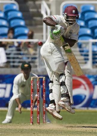 West Indies' Devon Smith jumps to avoid the ball during the first cricket test match against Australia in Kingston May 23, 2008. REUTERS/Andy Clark