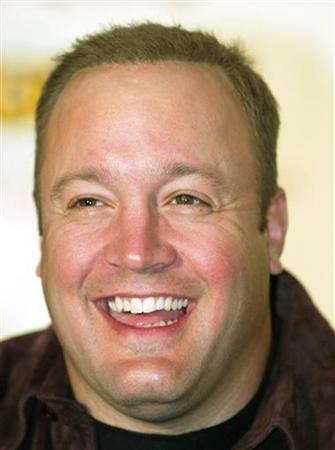 Actor/comedian Kevin James laughs during a news conference in Las Vegas April 20, 2002. REUTERS/Ethan Miller