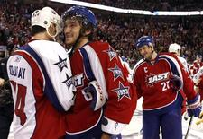 <p>East Conference all-star Alex Ovechkin (C) of the Washington Capitals shakes hands with West Conference all-star Sheldon Souray (L) of the Edmonton Oilers in front of Alexei Kovalev (R) of the Montreal Canadiens at the end of the NHL All-Star hockey game in Montreal, January 25, 2009. REUTERS/Christinne Muschi</p>