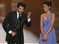 "<p>Actors Anil Kapoor and Freida Pinto (R) accept the award for Outstanding Performance by a Cast in a Motion Picture for ""Slumdog Millionaire"" at the 15th annual Screen Actors Guild Awards in Los Angeles, January 25, 2009. REUTERS/Lucy Nicholson</p>"