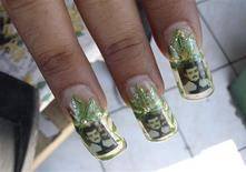 <p>A woman shows her nails decorated with marijuana leaves and images of narco patron saint Jesus Malverde in the northwestern city of Culiacan in this May 14, 2008 file photo. Rosenberg/Files</p>