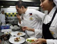 "<p>Eugenio ""Gene"" Gonzalez, a top-rated Filipino chef, tastes the sauce his students are working on during a class at the Center for Asian Culinary Studies in Manila. REUTERS/Cheryl Ravelo</p>"