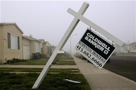 A bent over sign advertising a home for sale is shown in Daly City, California December 31, 2008. REUTERS/Robert Galbraith