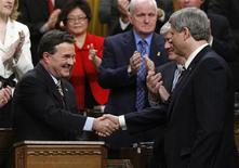 <p>Canada's Finance Minister Jim Flaherty (C) shakes hands with Prime Minister Stephen Harper after delivering his budget in the House of Commons on Parliament Hill in Ottawa January 27, 2009. REUTERS/Chris Wattie</p>