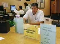 <p>Aniba Casavilca fills out a registration form as he begins his search for a job at the Verdugo Jobs Center, a partnership with the California Employment Development Department, in Glendale, California, in this November 7, 2008 file photo. REUTERS/Fred Prouser/Files</p>