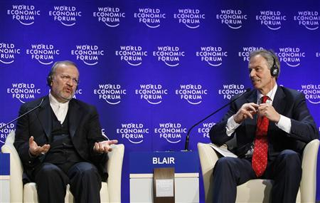 Iran's Foreign Minister Manouchehr Mottaki (L) and Tony Blair, Head of the Middle-East Quartet and Member of the Foundation Board of the World Economic Forum, attend a session at the World Economic Forum (WEF) in Davos January 29, 2009. REUTERS/Denis Balibouse