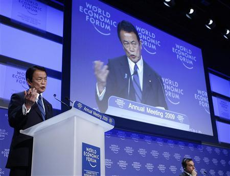 Japan's Prime Minister Taro Aso (L) makes a special address to the participants of the World Economic Forum (WEF) in Davos January 31, 2009. Germany and Britain called on Friday for a global economic watchdog with strengthened powers to prevent rather than react to financial crises that can spiral into worldwide recession. REUTERS/Christian Hartmann