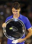 <p>O tenista número dois do mundo, Roger Federer, lamentou tudo que não aconteceu depois de perder uma final eletrizante de cinco sets para Rafael Nadal no Aberto da Austrália, neste domingo. REUTERS/Tim Wimborne (AUSTRALIA)</p>