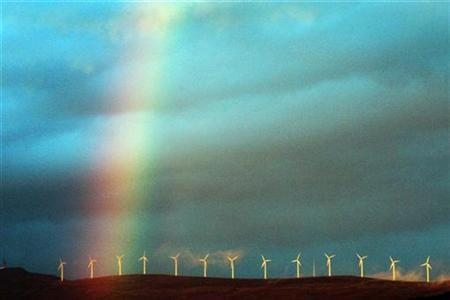 A rainbow hangs over electricity-producing wind turbines near the Spanish Basque town of Durango December 8, 2007. REUTERS/Vincent West