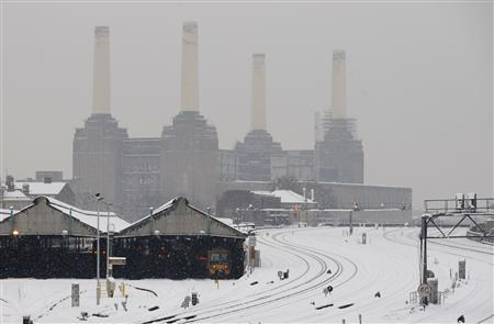 Trains are seen in their depots in front of Battersea Power Station in London, February 2, 2009. REUTERS/Toby Melville