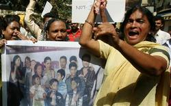 <p>Residents of Asia's largest shanty town, Dharavi, display posters and placards as they protest against the producers of film 'Slumdog Millionaire' in Mumbai February 3, 2009. In recent weeks the movie's success around the world has been overshadowed by objections in India to the name, which some slum dwellers find offensive, its depiction of the lives of impoverished Indians and the treatment of the cast. REUTERS/Punit Paranjpe</p>