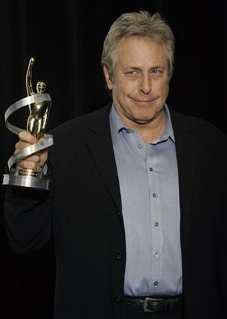Charles Roven, honored as Producer of the Year, poses with his award before the 2008 ShoWest Awards ceremony in Las Vegas, Nevada, March 13, 2008. REUTERS/Steve Marcus